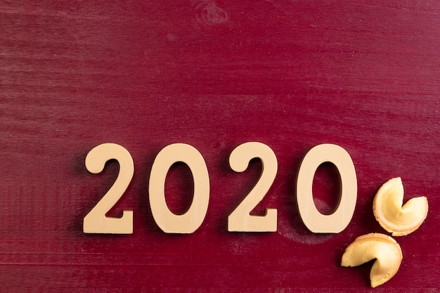 New chinese year number and fortune cookies on red background Free Photo