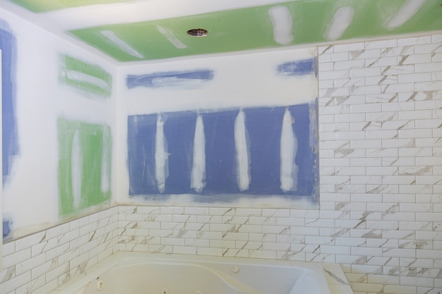 New under construction bathroom interior with drywall and patching Premium Photo