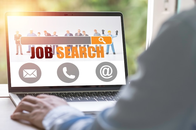 New graduate using laptop look for online new job search from head hunters website. recruitment concept. Premium Photo