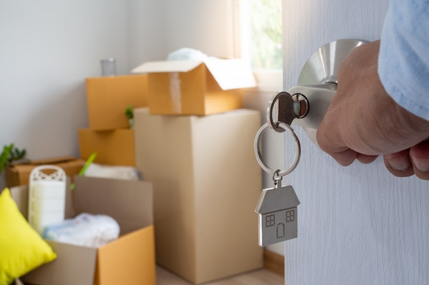 The new home owner opens the door of the room Premium Photo