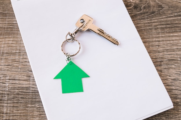 New house key on paper Free Photo
