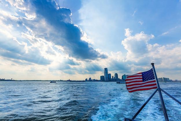 New jerysey city skyline with american flag Premium Photo