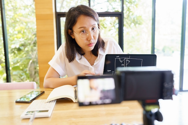 New normal asian woman aged 30-35 years, vlogger coach presentation training people online. Premium Photo