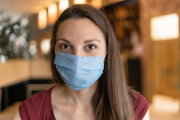 New normal concept of woman with mask eating in restaurant Premium Photo