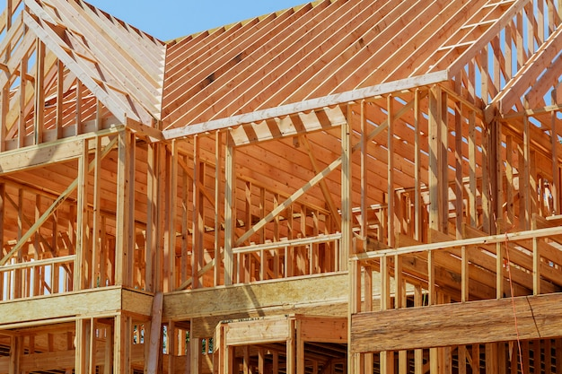 New residential construction home framing against a blue sky. Premium Photo
