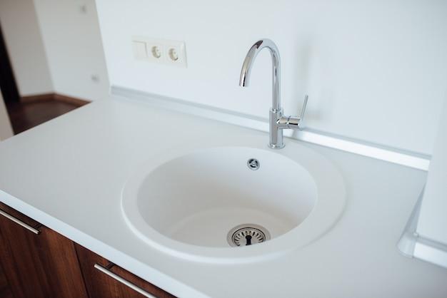 New sink in the kitchen Premium Photo