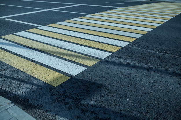 New white and yellow pedestrian bacground in the city Premium Photo