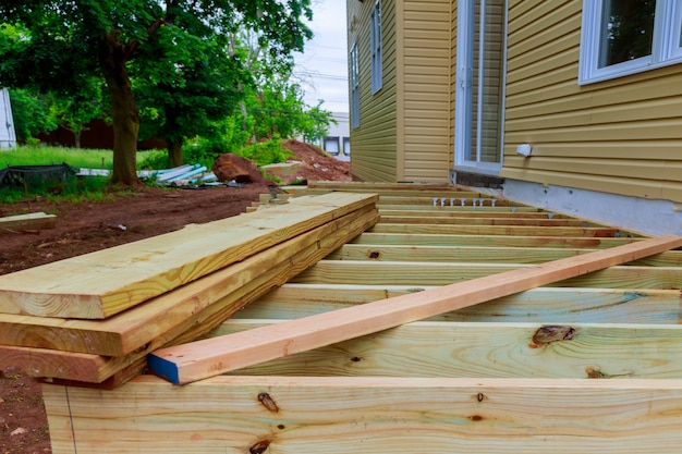 A new wooden, timber deck being constructed Premium Photo