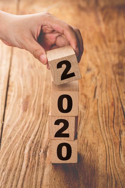 New year 2019 change to 2020 hand change wooden cubes. Premium Photo
