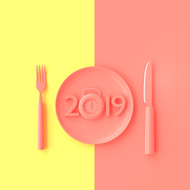 New year 2019 concept and clock pink color in plate with fork and knife. Premium Photo