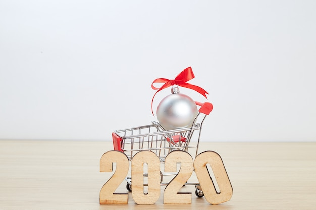 New year 2020 festival shopping concept on wooden Premium Photo