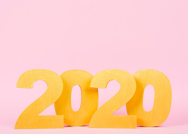 New year 2020 numbers on pink background with copy space Free Photo