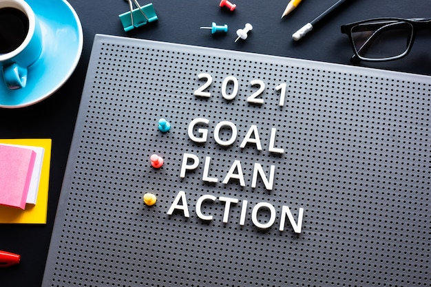 New year 2021,goal,plan,action text  with text on desk table.business management.motivation to success concepts ideas Premium Photo