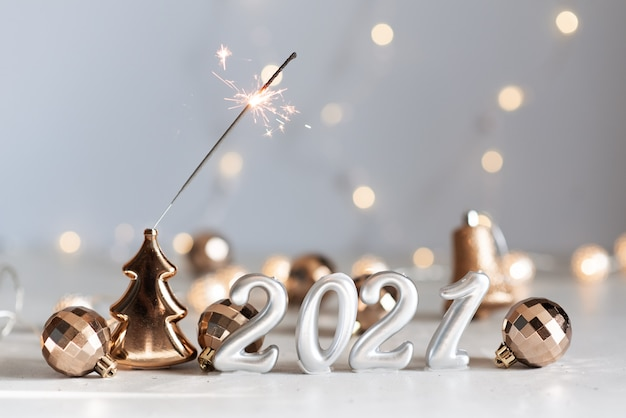 New year 2021 silver balloons with fireworks Premium Photo