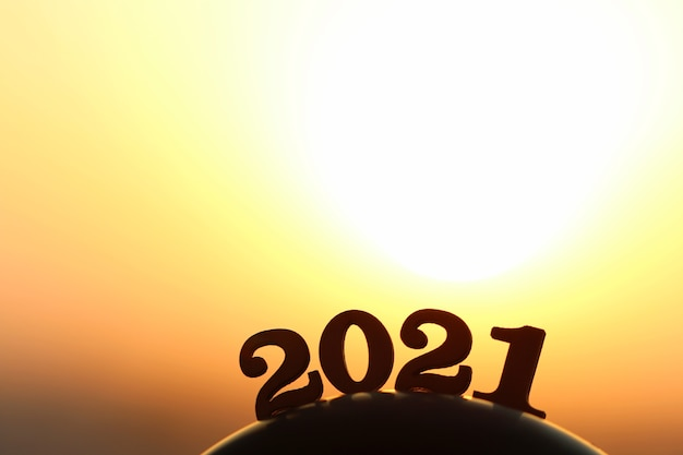New year 2021. the word 2021 behind the mountain at golden sunset and beautiful sky. Premium Photo
