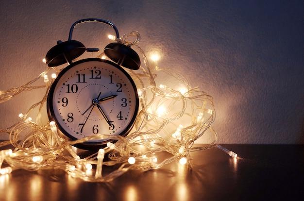 New year alarm clock with vintage gold shining Premium Photo