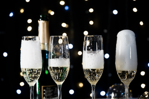 New year background with champagne glasses Free Photo