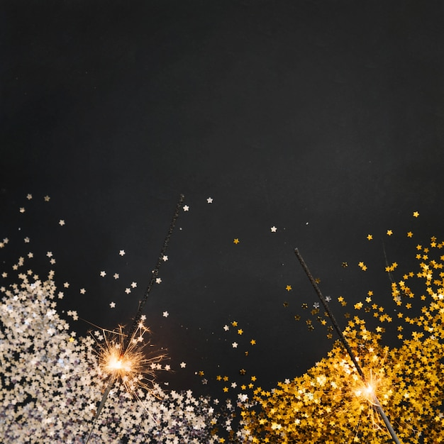 new year background with confetti and sparklers free photo