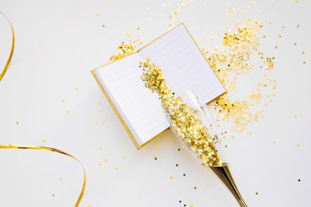 new year background with open book and golden confetti free photo
