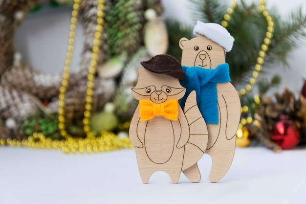 New year card with wooden toys bear and raccoon Premium Photo