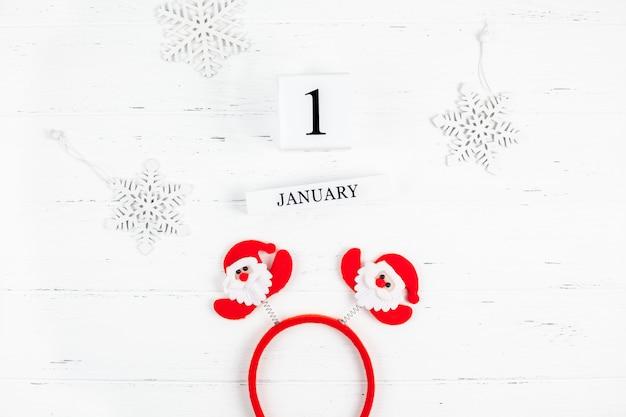 New year or christmas flat lay wooden calendar. 1 january Premium Photo