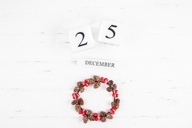 New year or christmas flat lay wooden calendar. 25 december Premium Photo