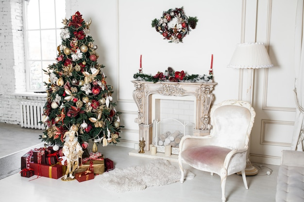 New year christmas holidays decorations in studio tree branches with baubles Premium Photo