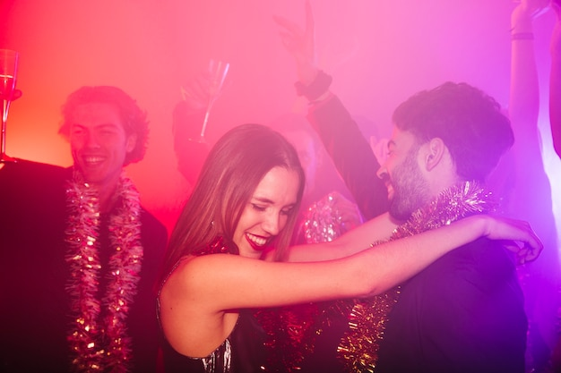 New year club party with happy couple Free Photo