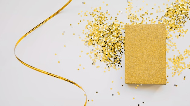 New year composition with golden book Free Photo