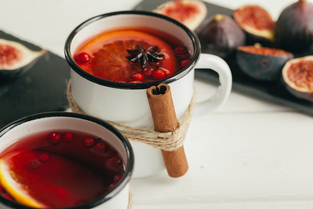 New year composition with mulled wine on dark wooden background Premium Photo