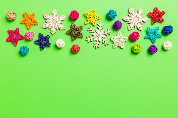 New year decorations on green background. festive stars and balls. merry christmas concept with empty space for your design Premium Photo