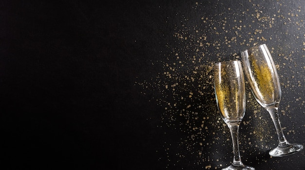 New year holidays background concept made from champagne glasses with golden glitter Premium Photo