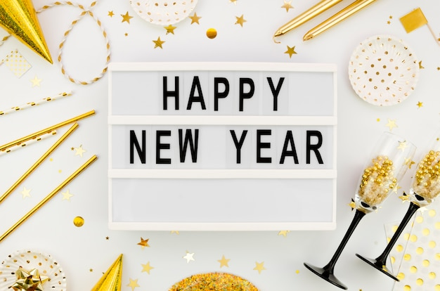 New year lettering  with golden accessories Free Photo