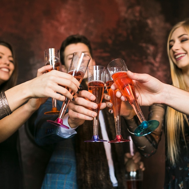 New year party and friendship concept with friends toasting 23 2147720549