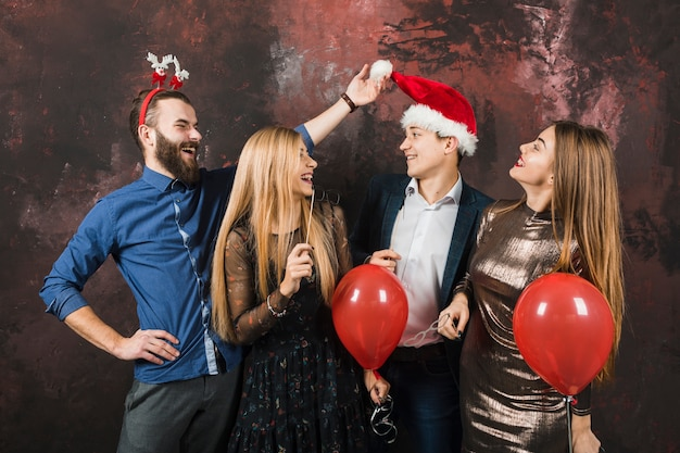 New year party concept with four happy friends Free Photo