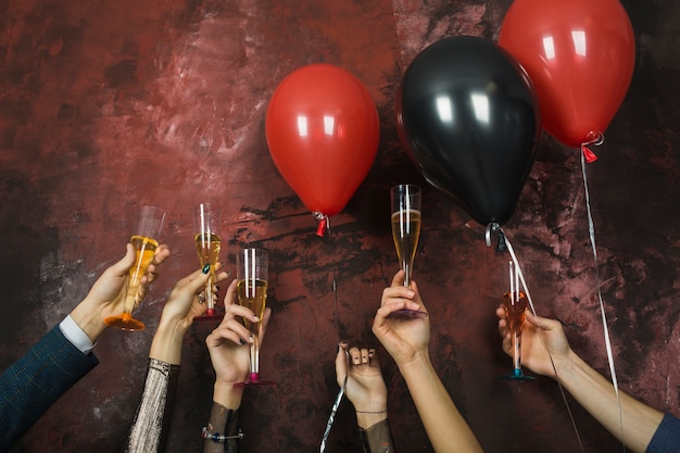 New year party concept with hands Free Photo