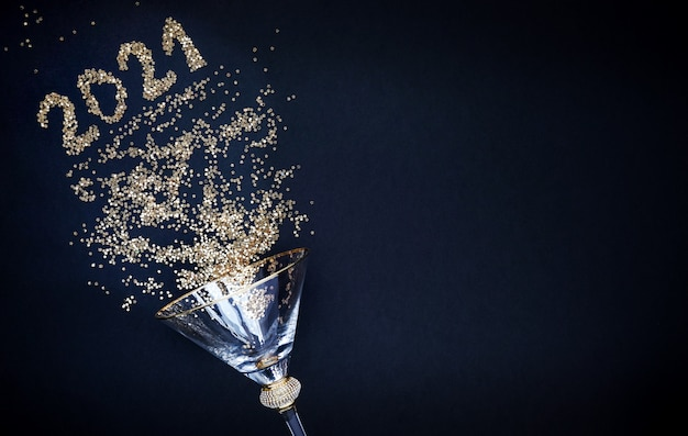 New year's and christmas. shiny glass on a black background. shiny numbers 2021 copy space Premium Photo