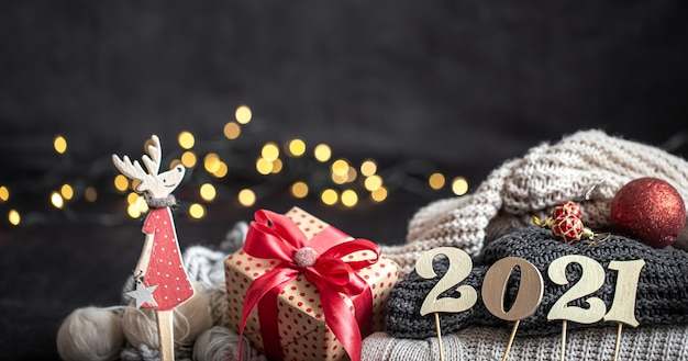 New year's composition with wooden new years number and christmas decorations on a dark background. Free Photo