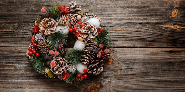 New year's wreath of spruce and  christmas gifts decorations Premium Photo