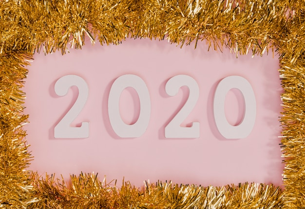 New years sign with tinsel frame Free Photo