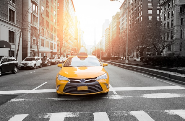 New york city taxi in yellow color in the traffic light Premium Photo