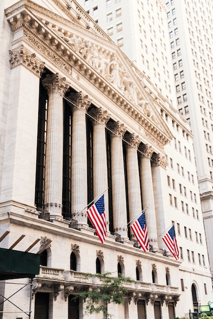 New york stock exchange facade with flags Free Photo