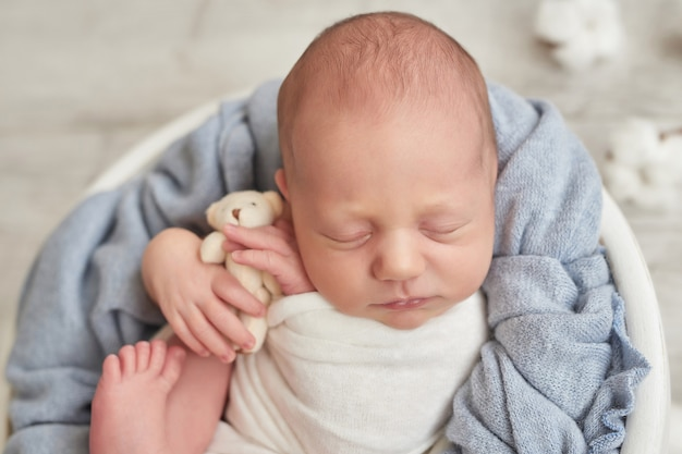 Newborn baby boy sleeping Premium Photo