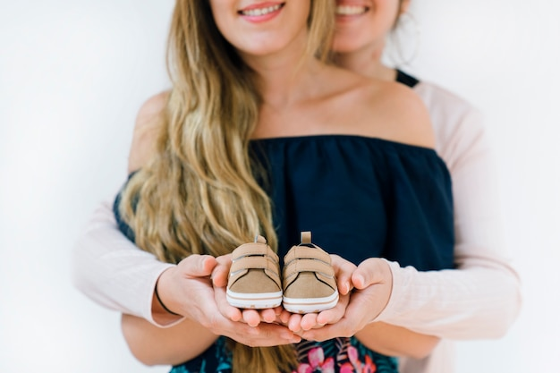 Newborn concept with lesbian couple Free Photo