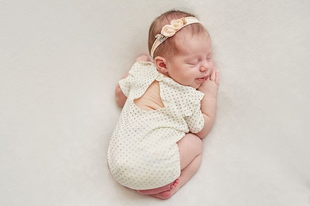Newborn girl on a light background Premium Photo