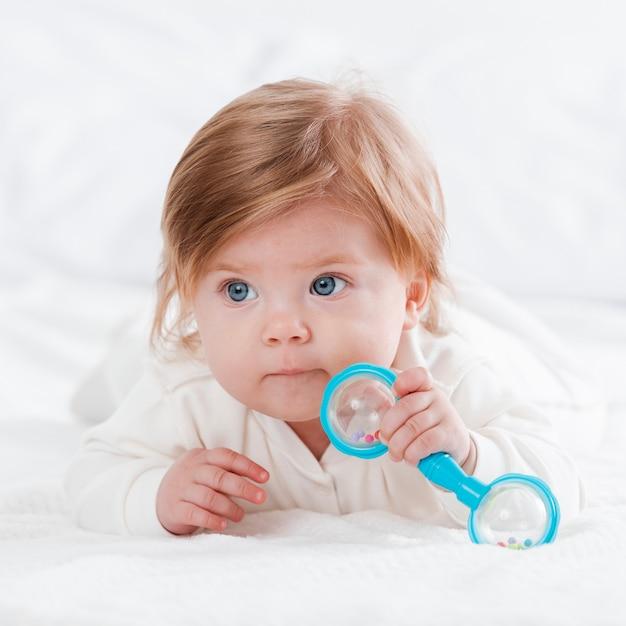 Newborn posing with toy Free Photo