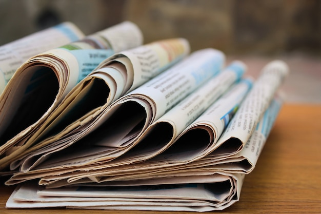 Newspapers on the table Premium Photo