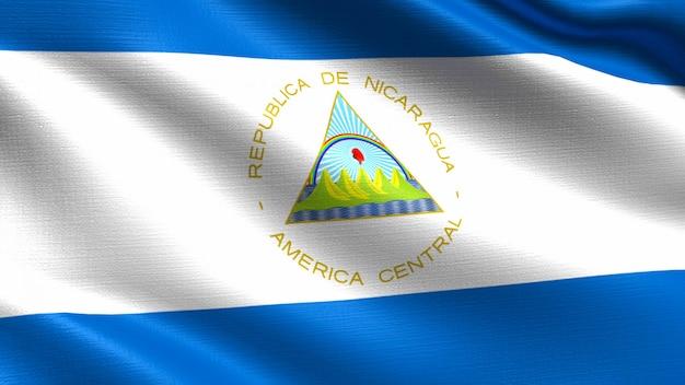 Nicaragua flag, with waving fabric texture Premium Photo