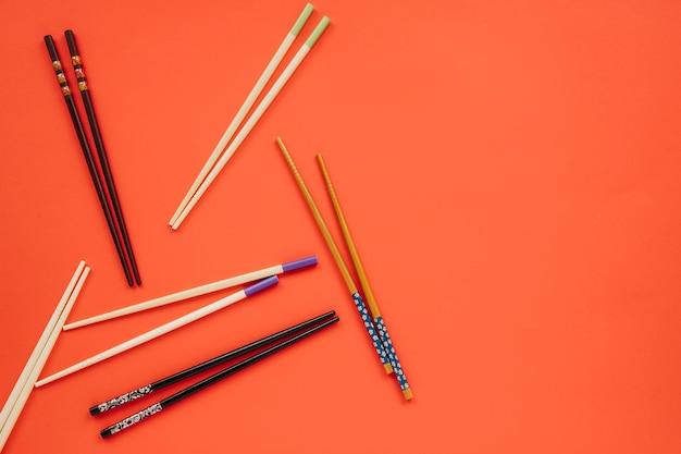 Nice chopsticks on red Free Photo