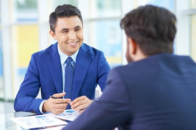 Nice meeting between businessmen Free Photo